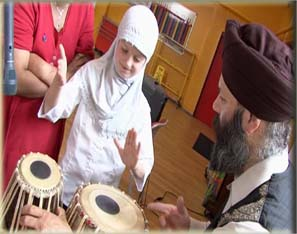 Tufaan - Child Learning Tabla Still